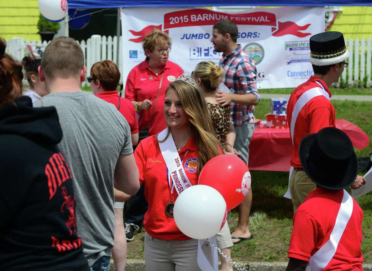Barnum Festival Princess Victoria Fatovic hands out balloons at the 5th Annual