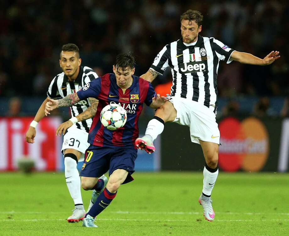 Lionel Messi, center, and Barcelona's relentless offense were too formidable for Claudio Marchisio, right, and Juventus on Saturday in Berlin. Photo: Paul Gilham, Staff / 2015 Getty Images