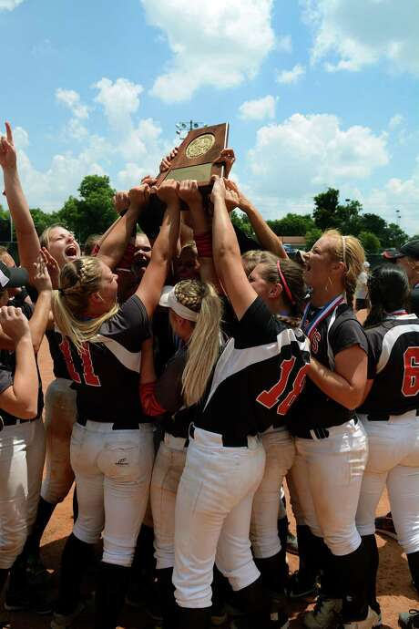 Huffman Hargrave's players hoist a state championship trophy for the first time in program history after Saturday's win over Needville. Photo: Jerry Baker, Freelance