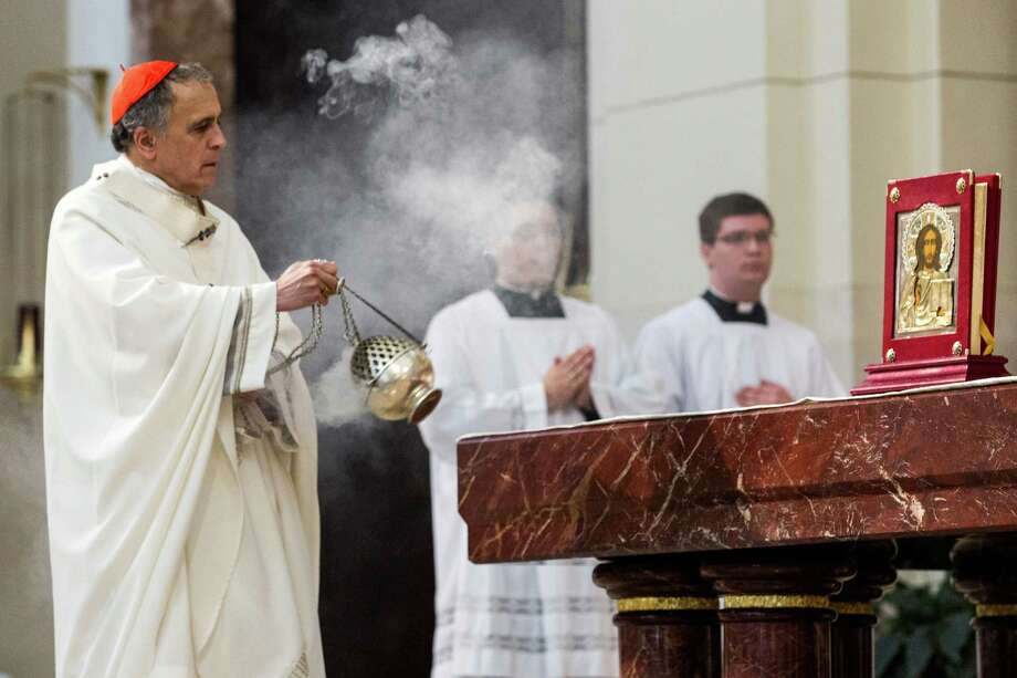 Cardinal Daniel N. DiNardo blesses the altar with incense during the Celebration of the Eucharist and Ordination to the Priesthood at the Co-Cathedral of the Sacred Heart on Saturday, June 6, 2015, in Houston. Five new priests were ordained during the ceremony. Photo: Brett Coomer, Houston Chronicle / © 2015 Houston Chronicle