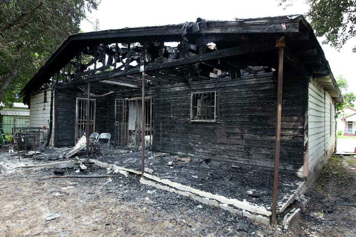 A home at 1534 Center St. in San Antonio was destroyed by a fire of unknown origin Friday evening, June 5, 2015. The home was a rental property owned by Ivy Taylor and her husband, Rodney. According to the tenant's brother-in-law, Richard Alvarez Jr., he'd arrived at the house around 11 p.m. Friday, and his nieces and nephews were running out shouting fire. The back room was fully in flames. He and the mother of his nieces, Cecilia Rodriguez, tried to put it out with a small fire extinguisher but were unsuccessful. Alvarez said the smoke alarms were not working. No one was hurt in the fire.