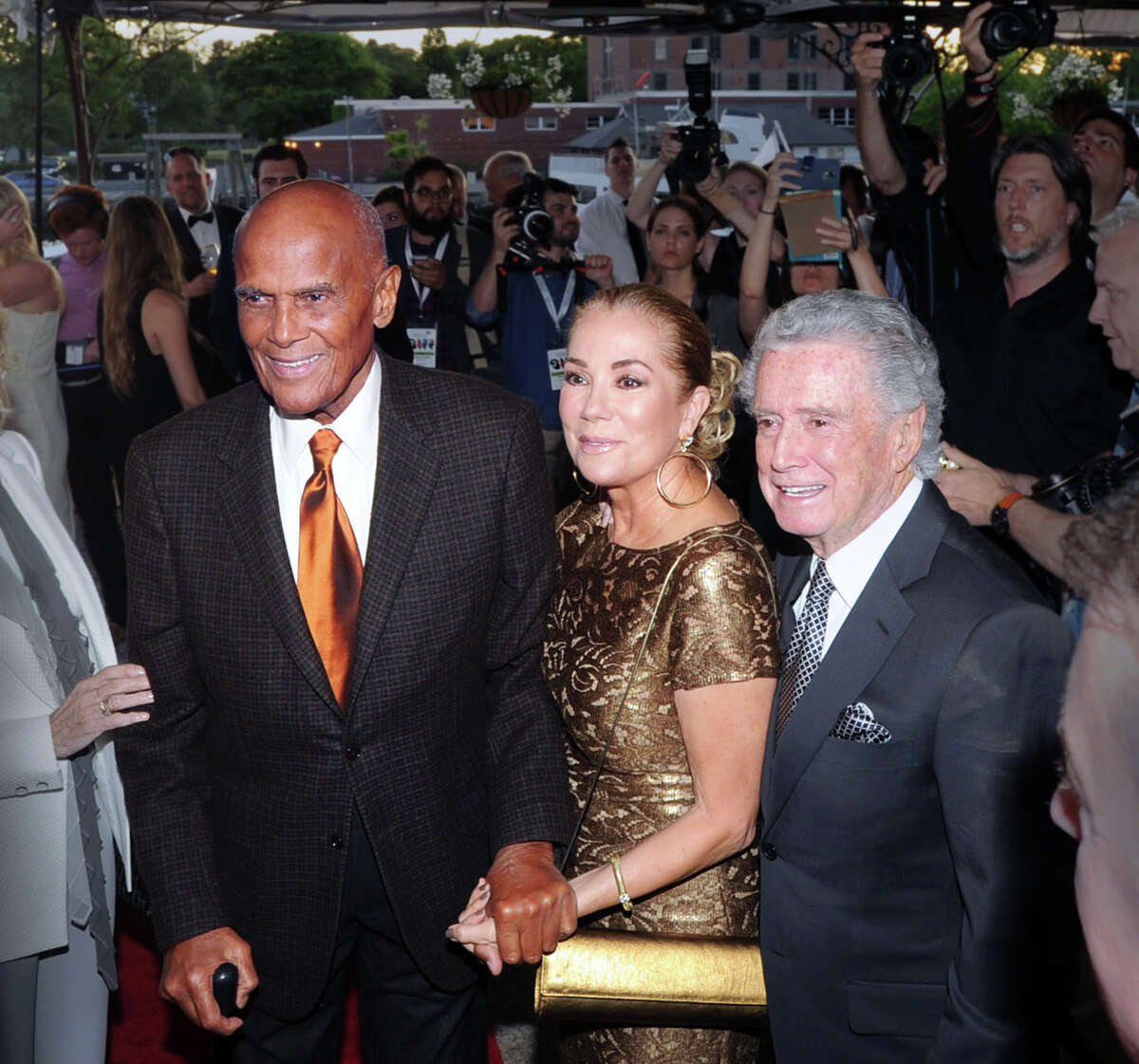 Honoree Harry Belafonte, left, with Kathie Lee Gifford, center, and Regis Philbin, right during the Greenwich International Film Festival Gala honoring Belafonte for his philanthropic work, particularly with UNICEF, at L'escale Restaurant & Bar in Greenwich, Conn., Saturday night, June 6, 2015. Gifford and Philbin were Master of Ceremonies for the gala.