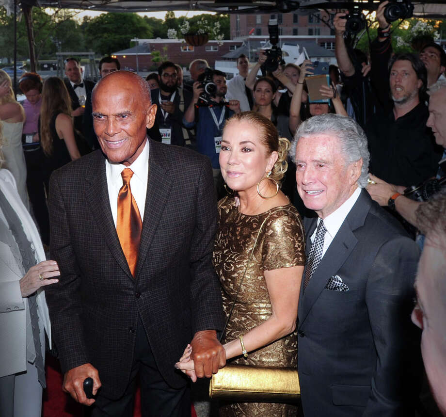 Honoree Harry Belafonte, left, with Kathie Lee Gifford, center, and Regis Philbin, right during the Greenwich International Film Festival Gala honoring Belafonte for his philanthropic work, particularly with UNICEF, at L'escale Restaurant & Bar in Greenwich, Conn., Saturday night, June 6, 2015. Gifford and Philbin were Master of Ceremonies for the gala. Photo: Bob Luckey / Greenwich Time