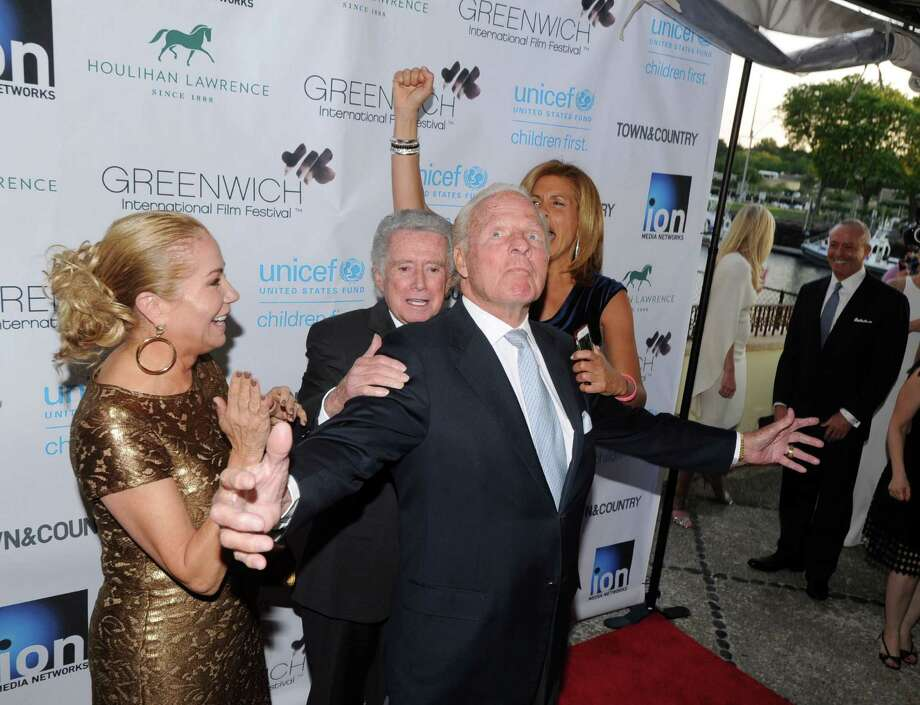 At center, N.Y. Giant football legend, Frank Gifford of Greenwich hams it up for the cameras during the Greenwich International Film Festival Gala honoring Harry Belafonte for his philanthropic work with UNICEF at L'escale Restaurant & Bar in Greenwich, Conn., Saturday night, June 6, 2015. At left is Gifford's wife, Kathie Lee Gifford, with Regis Philbin (behind Frank Gifford) and Hoda Kotb at right. Photo: Bob Luckey / Greenwich Time