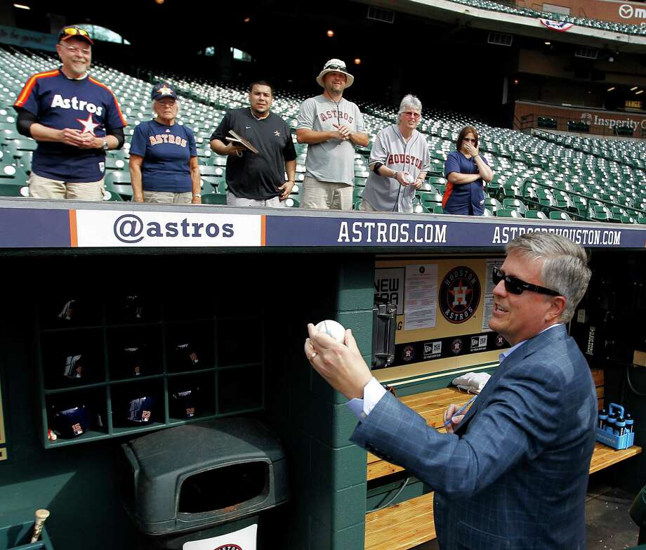 Houston Astros GM Jeff Luhnow signs autographs before the start of the MLB game at Minute Maid Park on Wednesday, April 8, 2015, in Houston.   ( Karen Warren / Houston Chronicle  ) Photo: Karen Warren, Staff / © 2015 Houston Chronicle
