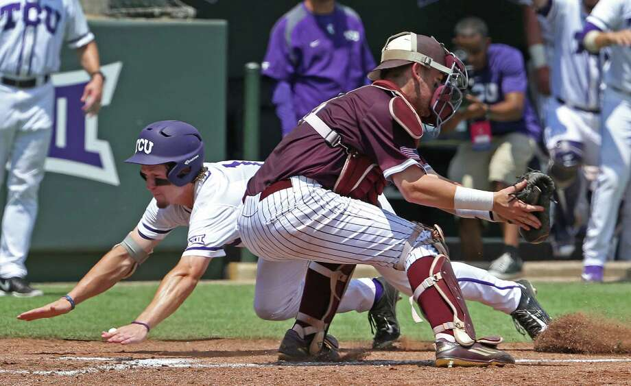 TCU's Cody Jones dives in to home plate as Texas A&M catcher Michael Barash takes the late throw on a second-inning two-run triple by teammate Jeremie Fagnan in Game 1 of the NCAA Super Regional at Lupton Stadium in Fort Worth, Texas, on Saturday, June 6, 2015. TCU won, 13-4. (Paul Moseley/Fort Worth Star-Telegram/TNS) Photo: Paul Moseley, MBR / McClatchy-Tribune News Service / Fort Worth Star-Telegram