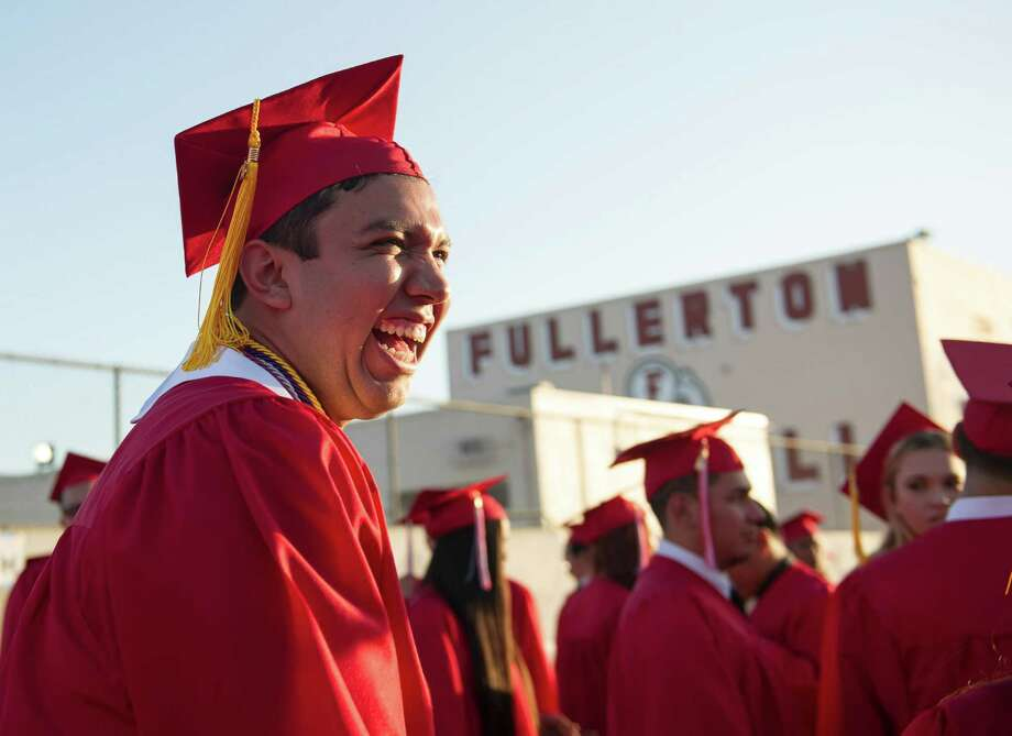 In this May 28, 2015 photo, Fernando Rojas, a senior at Fullerton High School, attends his graduation ceremony in Fullerton, Calif. Rojas, the son of Mexican immigrants, was accepted into all eight Ivy League schools. He is planning on attending Yale University in the fall. (Rose Palmisano/The Orange County Register via AP) Photo: ROSE PALMISANO, CONTRIBUTING PHO, MBI / The Orange County Register