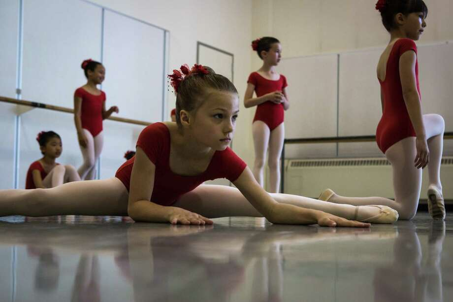 Students stretch before performing in Pacific Northwest Ballet's 21st annual DanceChance Observation Day on Saturday, June 6, 2015. The program offers full scholarships for students to train twice a week with the PNB School. The performance showcased the dancers' hard work for friends, family and supporters of the program. Photo: DANIELLA BECCARIA, SEATTLEPI.COM / SEATTLEPI.COM