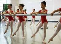 Students perform during Pacific Northwest Ballet's 21st annual DanceChance Observation Day on Saturday, June 6, 2015. The program offers full scholarships for students to train twice a week with the PNB School. The performance showcased the dancers' hard work for friends, family and supporters of the program.