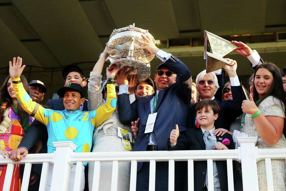 ELMONT, NY - JUNE 06:  Victor Espinoza (L), jockey of American Pharoah #5, owner of Ahmed Zayat, and trainer Bob Baffert (R), celebrate with the Belmont Stakes and Triple Crown Trophies after winning the 147th running of the Belmont Stakes at Belmont Park on June 6, 2015 in Elmont, New York. With the wins American Pharoah becomes the first horse to win the Triple Crown in 37 years  (Photo by Elsa/Getty Images) Photo: Elsa, Staff / Getty Images / 2015 Getty Images