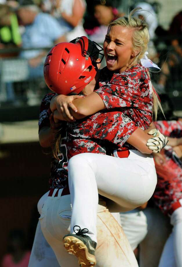 Katy's KaLee Howard celebrates winning a state title in the arms of teammate Emily Hitt after the final out of the Tigers' 3-2 victory over Lewisville in Austin on Saturday. Photo: Jerry Baker, Freelance