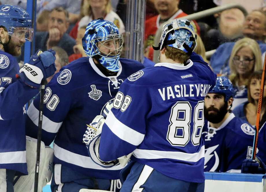 Lightning goalie Ben Bishop, left, is replaced by  Andrei Vasilevskiy in the third period. Vasilevskiy made 5 saves in 9 minutes for his first playoff win. Photo: Chris O'Meara, STF / AP