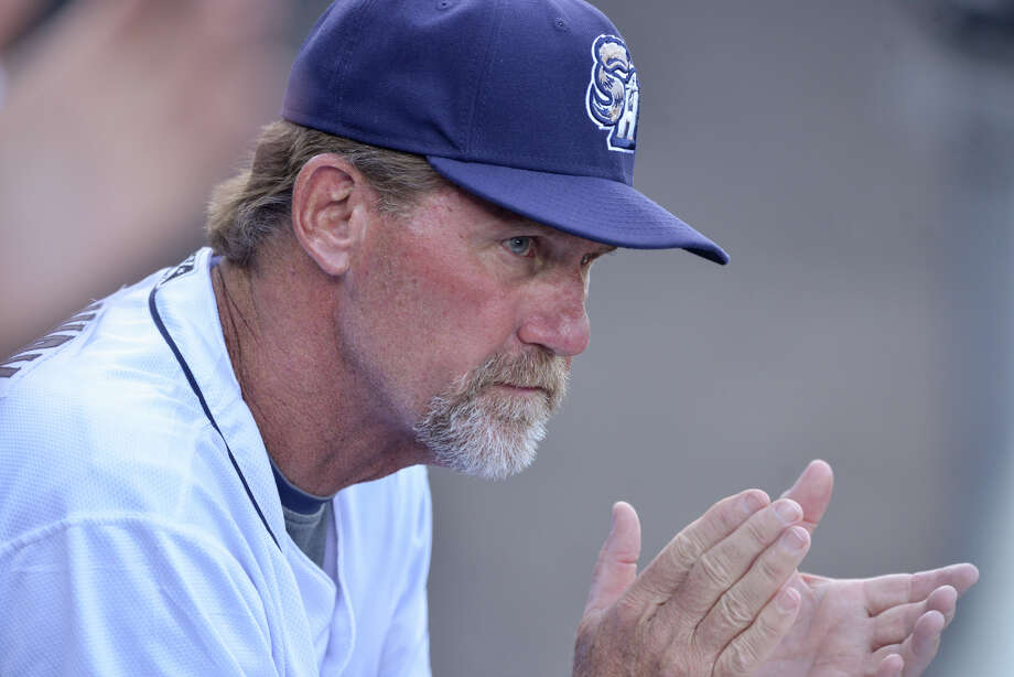 Missions Manager Jamie Quirk watches a recent game from the dugout of Wolff Stadium. Photo: Robin Jerstad /For The Express-News