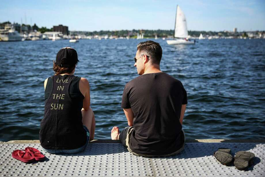 Archive photo: Jack Johnson and Nick Hughes look out over Lake Union during. Highs are expected to creep into the high 60s today in Seattle. Photo: JOSHUA TRUJILLO, SEATTLEPI.COM / SEATTLEPI.COM