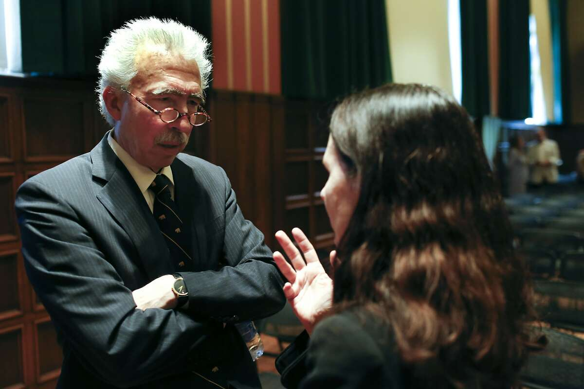 Chancellor Nick Dirks talks with a woman after his speech at the University of California Berkeley during the Benjamin Ide Wheeler Society Tea in Berkeley, Calif. on July 11, 2013.