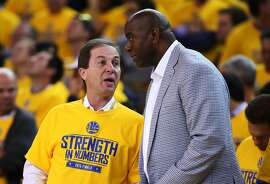 OAKLAND, CA - JUNE 04:  Magic Johnson speaks to Golden State Warriors owner Joe Lacob during Game One of the 2015 NBA Finals against the Cleveland Cavaliers at ORACLE Arena on June 4, 2015 in Oakland, California. NOTE TO USER: User expressly acknowledges and agrees that, by downloading and or using this photograph, user is consenting to the terms and conditions of Getty Images License Agreement.  (Photo by Ezra Shaw/Getty Images)