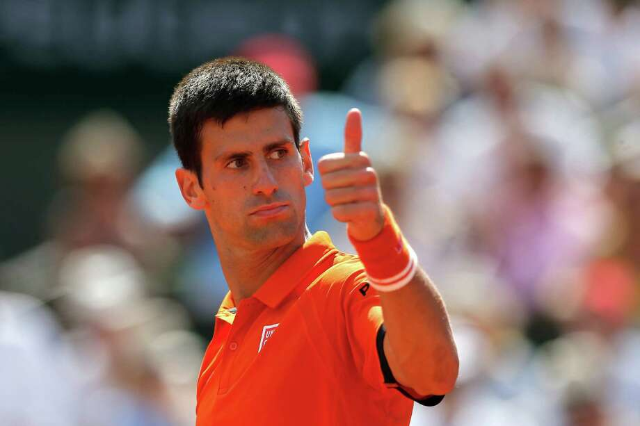 Serbia's Novak Djokovic thumbs up to congratulate Switzerland's Stan Wawrinka after Wawrinka's winning point during their final match of the French Open tennis tournament at the Roland Garros stadium, Sunday, June 7, 2015 in Paris. Photo: Francois Mori, AP / AP