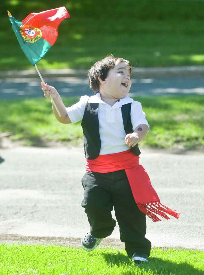 Gabriel DeSousa, 3 of Danbury, dances with the Portuguese flag as the Portuguese Day parade leaves Immaculate Heart of Mary Church on Deer Hill Ave in Danbury. Sunday, June 7, 2015 Photo: Scott Mullin, For The / The News-Times Freelance
