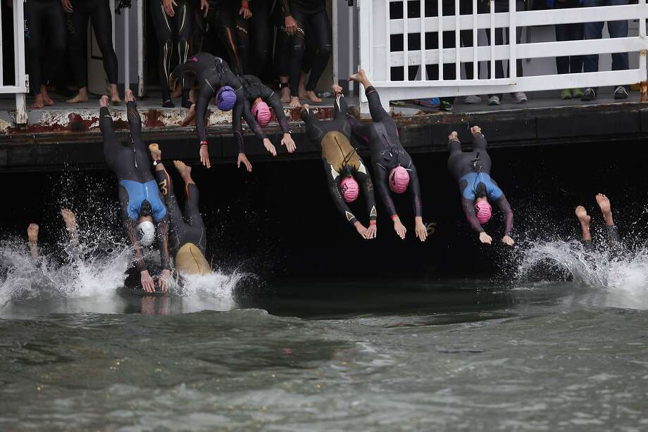 "Triathletes jump into the San Francisco bay to start the ""Escape from Alcatraz"" triathlon  in San Francisco, California, on Sunday, June 7, 2015. Photo: Brandon Chew, The Chronicle"