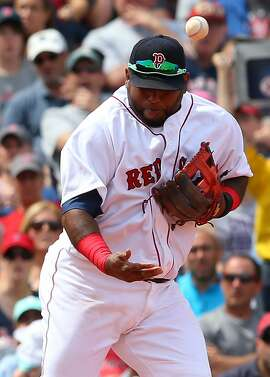 BOSTON, MA - JUNE 7: Pablo Sandoval #48 of the Boston Red Sox is unable to handle a ball hit by Mark Canha #20 of the Oakland Athletics in the fifth inning  at Fenway Park on June 7, 2015 in Boston, Massachusetts.  (Photo by Jim Rogash/Getty Images)