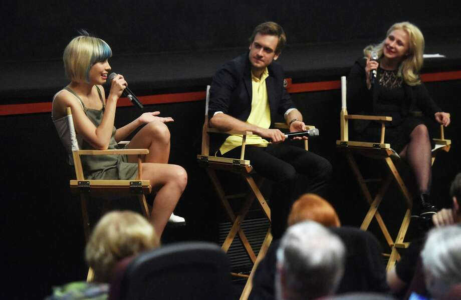 "From left, Pussy Riot's Nadya Tolokonnikova, Russian-Canadian activist Pyotr Verzilov and Pussy Riot's Masha Alekhina speak with during ""A Conversation with Pussy Riot"" during the Greenwich International Film Festival at Bow Tie Criterion Cinemas in Greenwich, Conn. Sunday, June 7, 2015.  Members of the Russian protest musical collective Pussy Riot spoke about their two-year imprisonment following an anti-Putin performance in Moscow and modern Russian and American societal and political issues.  The new Pussy Riot music video for ""I Can't Breathe,"" a song about Eric Garner, was screened in the theater. Photo: Tyler Sizemore, Staff Photographer / Greenwich Time"