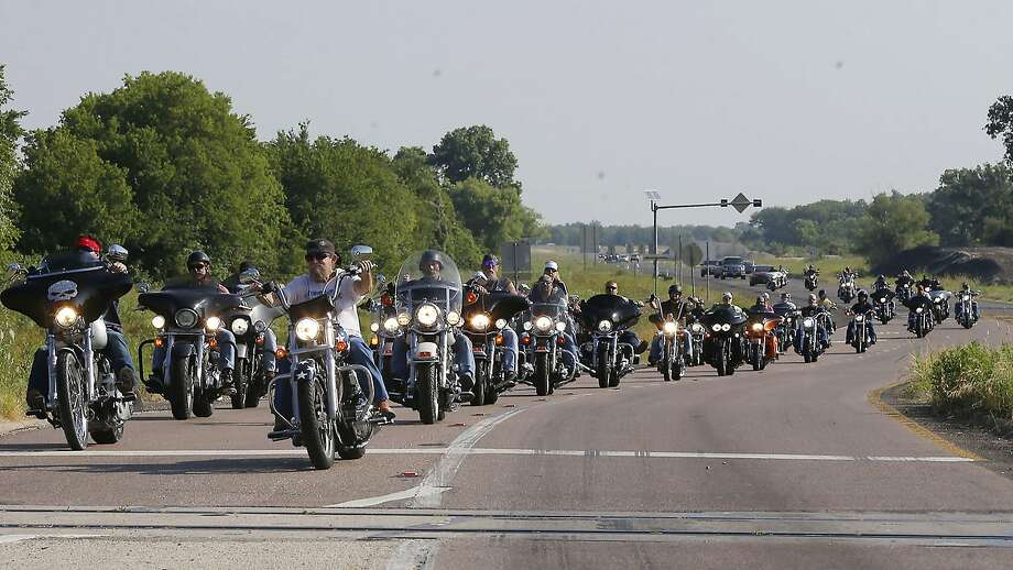 About 50 motorcycle riders parade down state Highway Loop 340 in Waco, Texas, during a rally in support of bikers who were jailed on May 17. Photo: Rod Aydelotte, Associated Press