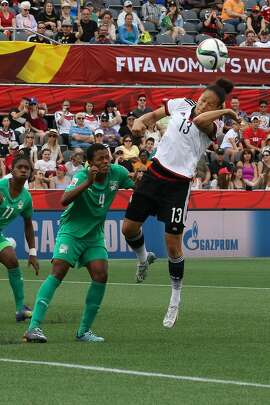 OTTAWA, ON - JUNE 7: Celia Sasic #13 of Germany jumps for a header against Nina Kpaho #4 of Cote d'Ivoire during the FIFA Women's World Cup Canada 2015 Group B match between Germany and Cote d'Ivoire at Lansdowne Stadium on June 7, 2015 in Ottawa, Canada. (Photo by Andre Ringuette/Getty Images)