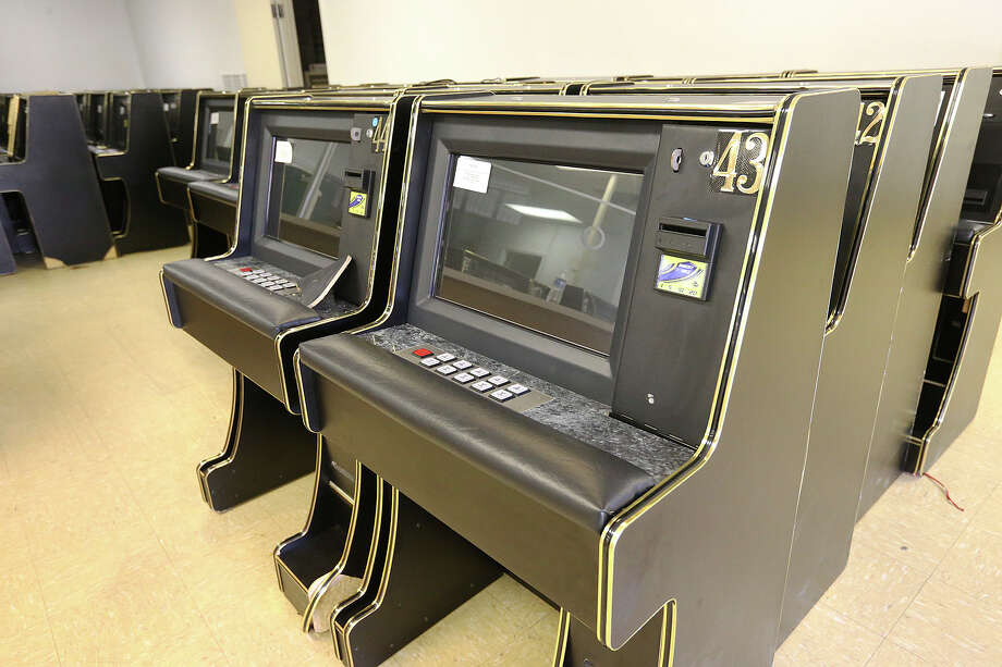 Eight liners gambling machines are stored in an unused office building in McAllen, Texas, Thursday, June 3, 2015. Hidalgo and Cameron counties have put pressure by raiding gambling establishments forcing most of them to go underground. Last year, Starr county officials embraced this burgeoning industry when it passed a $500 licensing fee per slot machine, touting the $1.7 million it would generate for the county. Photo: JERRY LARA, San Antonio Express-News / © 2015 San Antonio Express-News