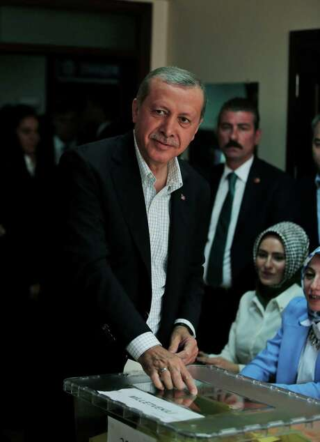 Turkey's President Recep Tayyip Erdogan casts his vote at a polling station in Istanbul, Turkey, Sunday, June 7, 2015. Turks are heading to the polls in a crucial parliamentary election that will determine whether ruling party lawmakers can rewrite the constitution to bolster the powers of Erdogan. All eyes will be on the results for the main Kurdish party, the Kurdish Peoples' Democratic Party, (HDP). If it crosses a 10 percent threshold for entering parliament as a party, that would extinguish AKP's constitutional plans. (AP Photo/Lefteris Pitarakis) Photo: Lefteris Pitarakis, STF / AP