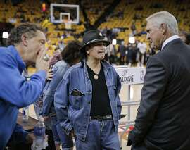 Larry Baer, Carlos Santana, and Jerry West chat prior to Game 2 of The NBA Finals between the Golden State Warriors and the Cleveland Cavaliers on Sunday, June 7, 2015 in Oakland, Calif.