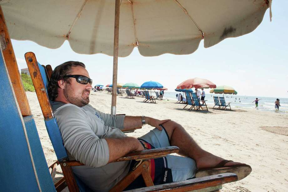 Frank Maceo watches over the section of beach where he rents chairs and umbrellas to beachgoers between 57th and 61st streets Sunday in Galveston. Photo: Alysha Beck, Freelance / Houston Chronicle
