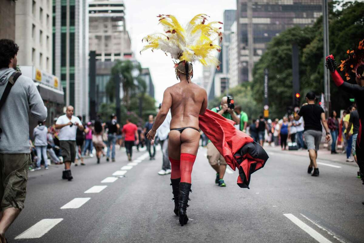 Revelers walks during the annual Gay Pride Parade in Sao Paulo, Brazil, Sunday, June 7, 2015. Hundreds of thousands gather every year on skyscraper-lined Avenida Paulista in Sao Paulo for one of the world's largest gay pride parades.