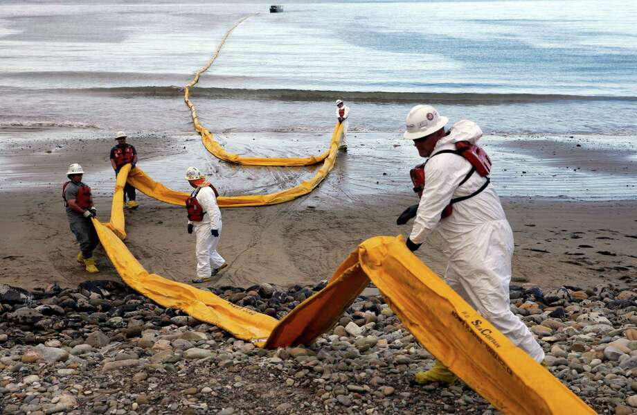 Workers prepare oil containment boom at Refugio State Beach, north of Goleta, Calif., after a pipeline ruptured in May.  Houston-based Plains All American Pipeline owns the pipeline.  Photo: Jae C. Hong, STF / AP