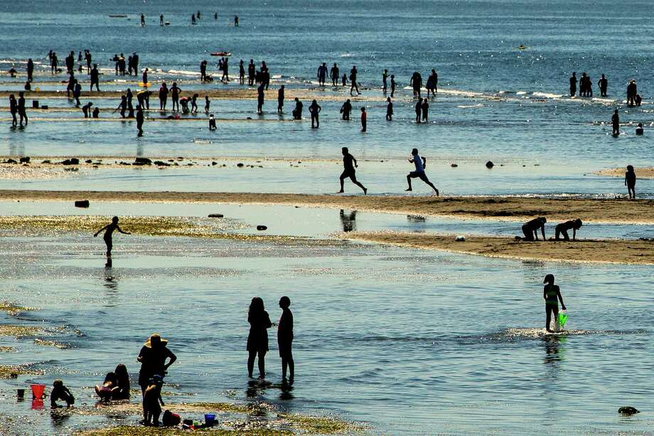 Thousands pack onto the sands of Alki Beach, photographed Sunday, June 7, 2015, in West Seattle. Temperatures climbed into the lower 80s in the Seattle area, drawing scores of people to area parks, beaches and water fountains. Photo: JORDAN STEAD, SEATTLEPI.COM / SEATTLEPI.COM