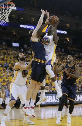 Golden State Warriors' Draymond Green goes for a lay up against Cleveland Cavaliers' Timofey Mozgov in the first period during Game 2 of The NBA Finals on Sunday, June 7, 2015 in Oakland, Calif.