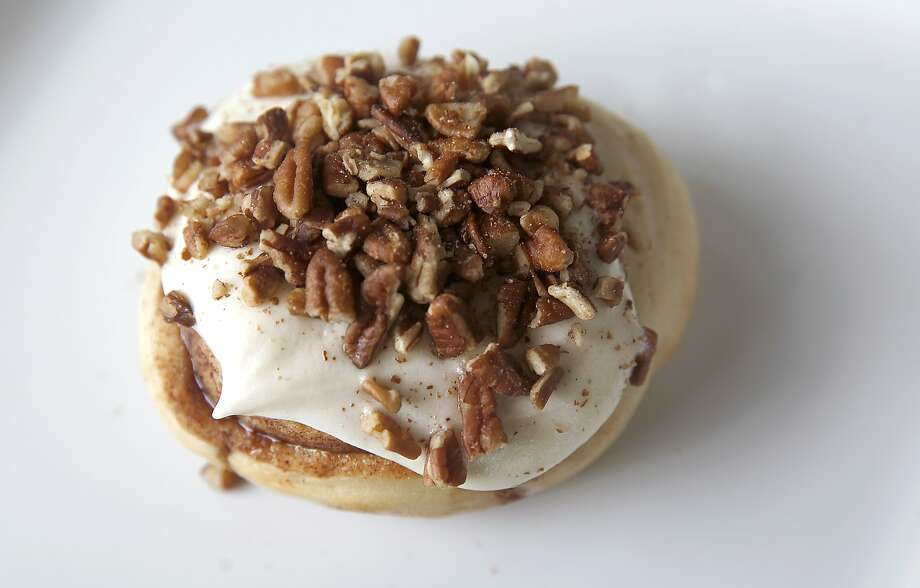 A butterscotch pecan cinnamon bun at Cinnaholic in Berkeley, where you can pick your frosting and pile on the toppings. Photo: Liz Hafalia, The Chronicle