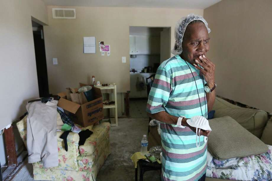 While mayoral candidates discus what can be done about Houston's flooding issues, some residents like Minthia Terry, 74, face the reality that cleanup and recovery will take a while. Photo: Mayra Beltran, Staff / © 2015 Houston Chronicle