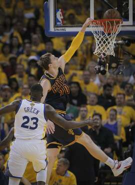 Cleveland Cavaliers' Timofey Mozgov tries to dunk in the first period during Game 2 of The NBA Finals on Sunday, June 7, 2015 in Oakland, Calif.