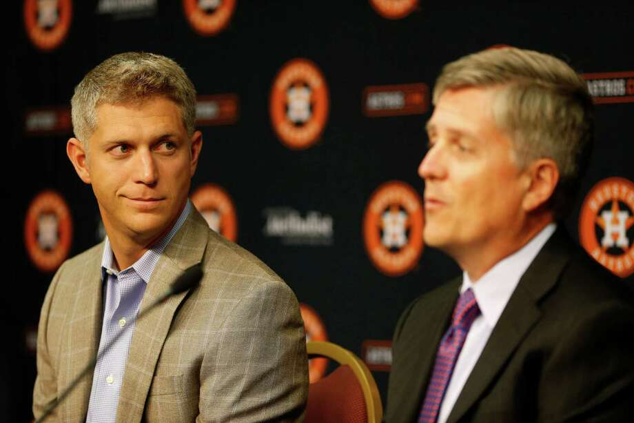 Astros general manager Jeff Luhnow (right) and amateur scouting director Mike Elias are in their fifth draft in Houston. Photo: Karen Warren, Staff / © 2015 Houston Chronicle