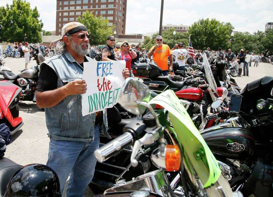 """Adam Valdez age 66, of Yoakum, Texas, arrives for the  """"All for 1"""" rally at the McLennan County courthouse parking lot in Waco, Texas, Sunday, June 7, 2015. Organizers, who have called the event a peaceful, silent protest, gathered in front of the courthouse to protest what they say is the violation of rights of many bikers who were arrested at Twin Peaks just for being at the scene of the crime. (Rod Aydelotte/Waco Tribune Herald via AP) Photo: Rod Aydelotte, MBO / Waco Tribune Herald"""