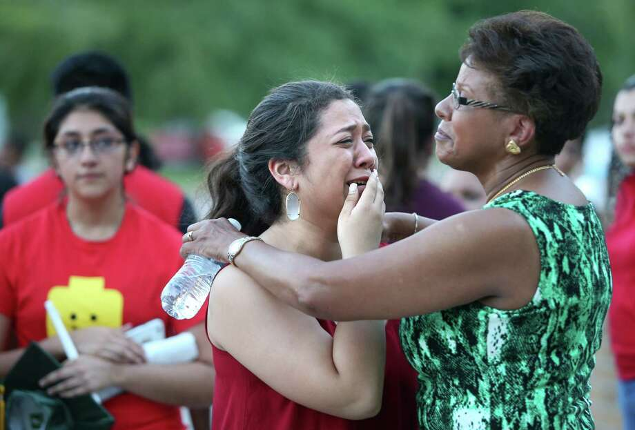 Senior Patsy Paredes is comforted by Principal Patricia Crittendon after the candlelight vigil in honor of student Omar Rodas held at Klein Forest High School on Sunday, June 7, 2015, in Houston. Omar Rodas died on his way to his high school graduation. Photo: Mayra Beltran, Houston Chronicle / © 2015 Houston Chronicle
