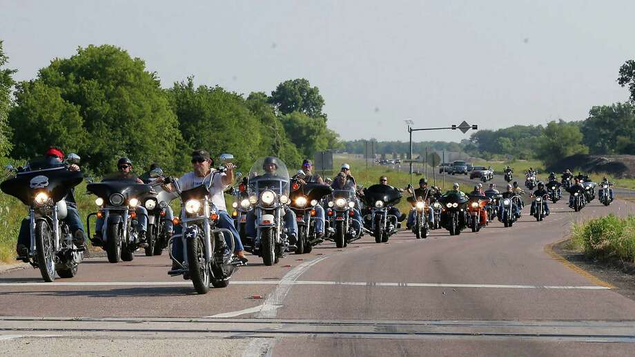 """About 50 motorcycle riders parade down loop 340 during  an """"All for 1"""" rally throughout Waco, Texas, Sunday, June 7, 2015. Organizers, who have called the event a peaceful, silent protest, will gather in front of the McLennan County Courthouse to protest what they say is the violation of rights of many bikers who were arrested May 17 at Twin Peaks just for being at the scene of the shootout. (Rod Aydelotte/Waco Tribune Herald via AP) Photo: Rod Aydelotte, MBO / Associated Press / Waco Tribune Herald"""