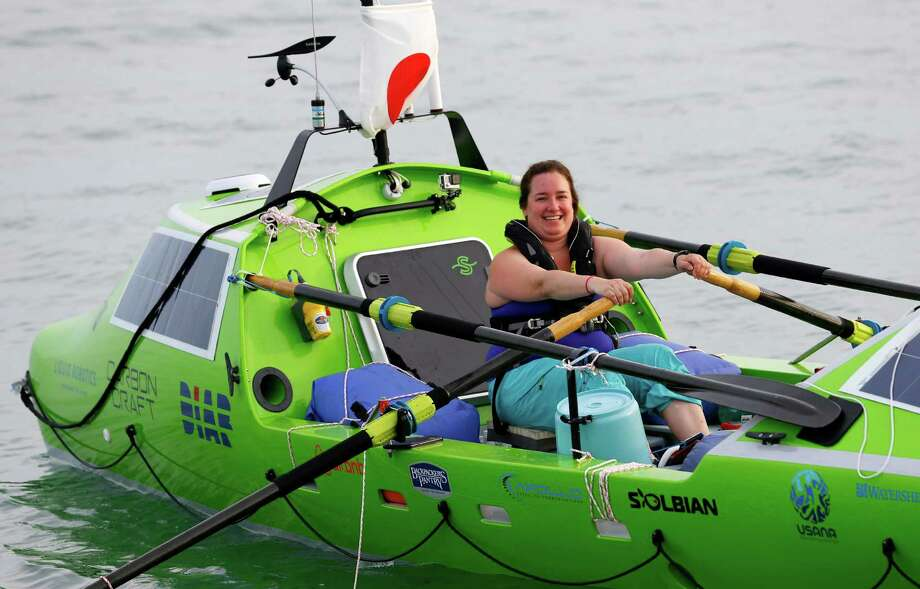 American rower Sonya Baumstein, from Orlando, Fla., rows Sunday as she leaves Choshi Marina in Choshi, a port east of Tokyo, headed for San Francisco. Baumstein hopes to finish the 6,000-mile journey by late September and become the first woman to row solo across the Pacific in the 23-foot-long vessel. Photo: Shizuo Kambayashi, STF / AP