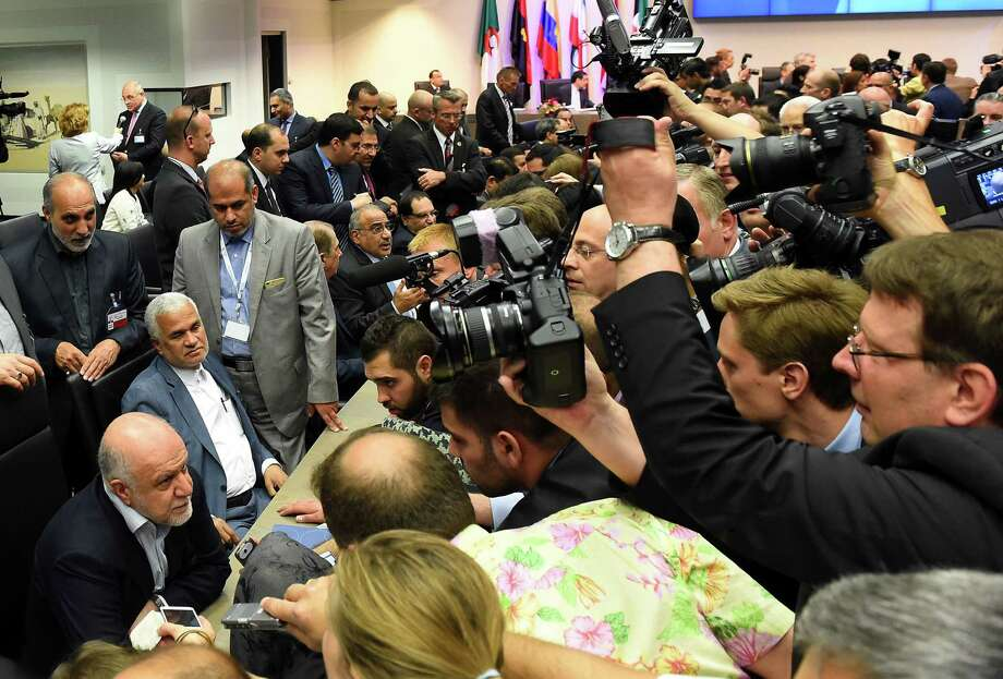 """Iran's Minister of Petroleum Bijan Zangeneh (bottom left) speaks to journalists during the 167th ordinary meeting of OPEC on Friday. """"They (OPEC) still matter, but they are not anymore the swing producer so they have a different role now than before,"""" says Giovanni Staunovo, a Zurich-based analyst at UBS AG. Photo: Joe Klamar /AFP / Getty Images / AFP"""