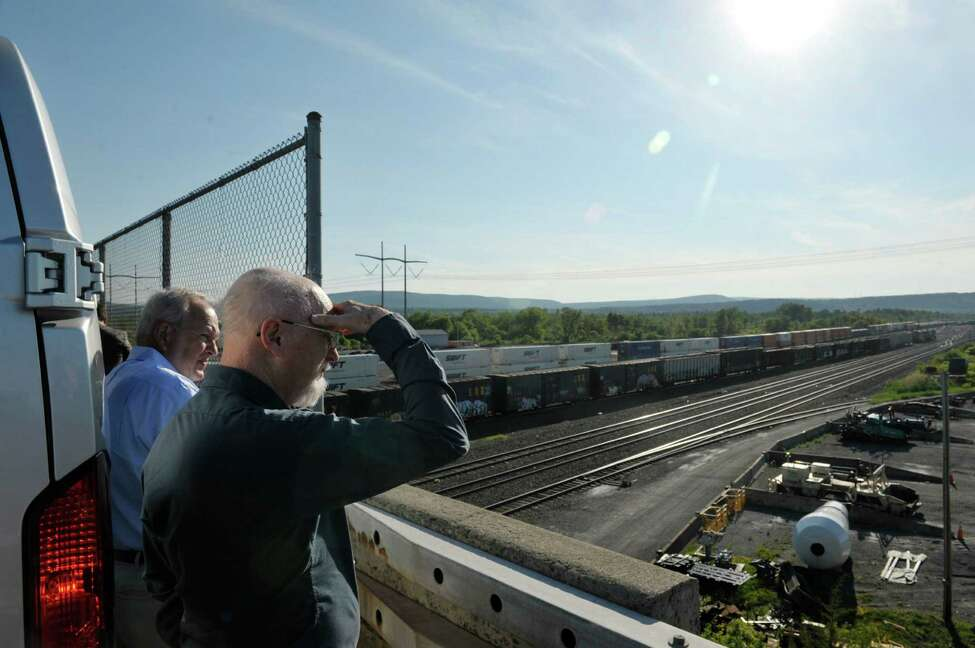 Chuck Pedersen, left, emergency management director, Jo Daviess County-Galena, IL and Fred Millar, an independent rail safety expert, look out over the Selkirk Rail Yard during a tour of areas impacted by the transportation of crude oil on Sunday, June 7, 2015, in Selkirk, N.Y. On Monday at the College of St. Rose a crude oil transportation summit will be held that the two men will take part in. (Paul Buckowski / Times Union)