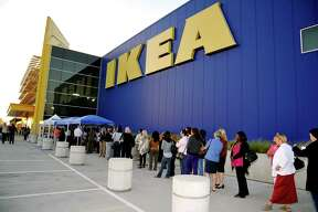 COVINA, CA - OCTOBER 19: (Editorial Use Only) IKEA customers line up to see television host Lisa Ling and the IKEA Life Improvement Squad kick off the third year of IKEA's Life Improvement Project, which helps customers make a positive impact on their homes and their lives within at IKEA on October 19, 2012 in Covina, California.