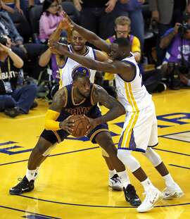 Golden State Warriors' Draymond Green and Andre Iguodala guard Cleveland Cavaliers' LeBron James in overtime during  Cavaliers' 95-93 win in Game 2 of the 2015 NBA Finals at Oracle Arena in Oakland, Calif., on Sunday, June 7, 2015.