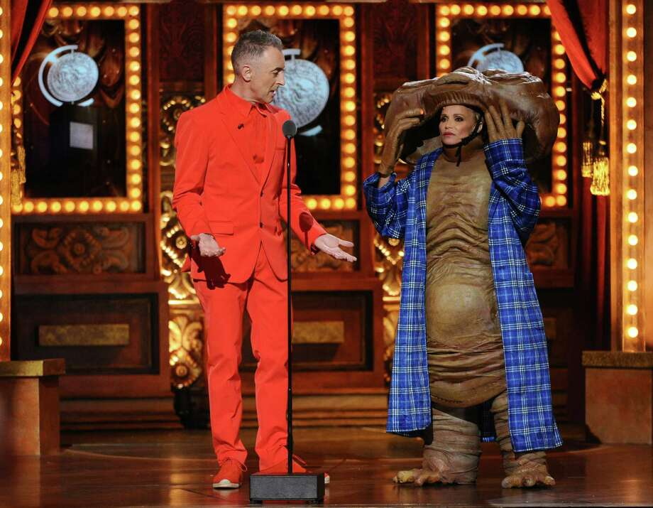 Alan Cumming, left, and Kristin Chenoweth don costumes for a skit while co-hosting the 69th annual Tony Awards at Radio City Music Hall on Sunday. June 7, 2015, in New York. (Photo by Charles Sykes/Invision/AP) Photo: Charles Sykes / Associated Press / Invision
