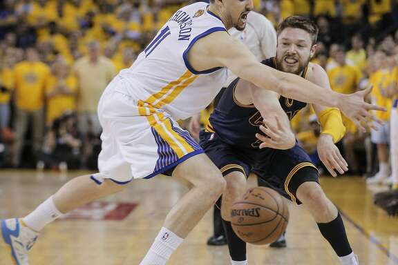 Cleveland Cavaliers' Matthew Dellavedova gets a pass by Golden State Warriors' Klay Thompson in the fourth period during Game 2 of The NBA Finals on Sunday, June 7, 2015 in Oakland, Calif.
