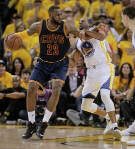 Golden State Warriors' Andre Iguodala tries to guard Cleveland Cavaliers' LeBron James in the second period during Game 2 of The NBA Finals on Sunday, June 7, 2015 in Oakland, Calif.